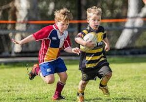 Young-boys-playing-rugby