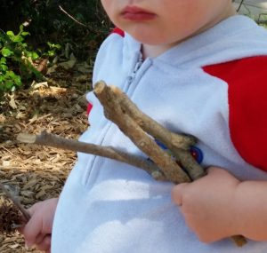 toddler_holding_sticks